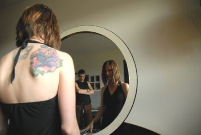 Woman pensively looking into the mirror