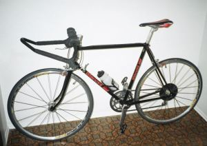 58cm black Bianchi bicycle against the wall